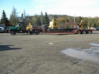 ROGERS® 55-ton Ultima trailer, custom-built for Guptill Logging, is seen here hauling a feller-buncher.