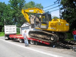 Rueben Schwartz regularly hauls a 160 John Deere track hoe and a 750 John Deere dozer on his Rogers® TAG25XXL trailer.