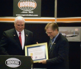 From left to right: Lyn Doverspike, Director of the Pittsburgh office of the U.S. Commercial Service, Mark Kulyk, President of Rogers Brothers Corporation, U. S. Congressman Mike Kelly.  Congressman Mike Kelly presented Mark Kulyk with The U.S. Commercial Service's Export Achievement Award.  Following the award ceremony, Mark Kulyk conducted a tour of the Rogers® factory.  This 121-ton capacity trailer was built by Rogers for a copper mining company in Peru.