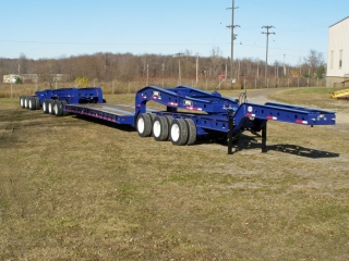 This custom rogers® 80-ton capacity, 13-axle trailer has a rocker shaft in the rear of the trailer that distributes weight to the rear six axles.