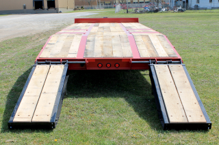 Wood covered loading ramps are 22 inches wide by 72 inches long and are laterally adjustable (shown at widest position).  Ladder style ramps are also available.