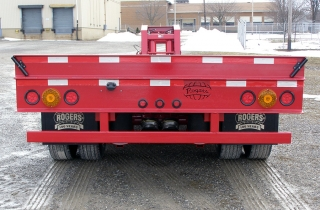 Safety features include reflective striping, flag holders, and a US DOT certified rear impact guard.  ROGERS red enamel finish.  Optional NYS-DOT 7