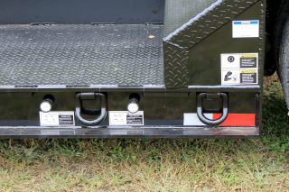 Air valves for 3rd axle air lift and suspension dump valve are conveniently located at the rear curbside of the trailer deck for easy access.