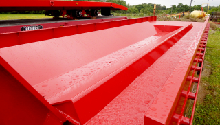 Coil well is 17 feet long and can haul coils up to 72 inches in diameter.  Coils of various width can be hauled lengthwise in the well - gun barrel style.