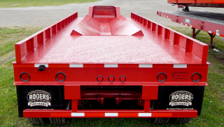 Trailer includes 2 volt LED lights, underride guard, and anti-sail mudflaps.  Deck surface is covered with 1/2 inch treadplate steel.