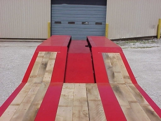 The platform deck has a 16° slope to the rear frame, covered with full 2-inch oak decking.  The center cover plate is depressed the full length of the slope and rear frame, which has 1/4