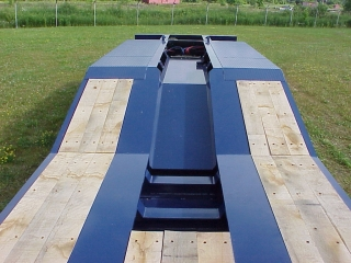 Notched cross members in the main deck for better overhead clearance of of an excavator's boom.  The recessed cover plate in the center rear frame reduces road spray.