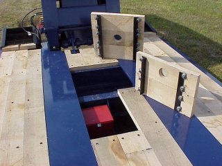 Wood-covered toolboxes provide storage in the deck for chains and blocks.  This space also has stores the battery for the self-powered auxiliary light system.