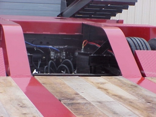 The standard arch-type rear frame with sloped bridge ramps allows machines clear access to load on rear frame.