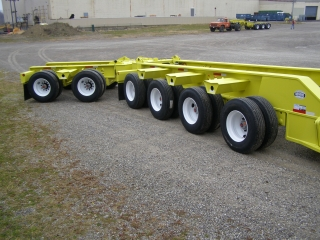 4-axle detachable rear frame with pin and paddle design Air/Light lines extended for booster assembly and rear bogie Removable/flip tandem axle rear bogie
