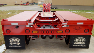 Several items are shown in this photo:  - Welded treadplate wheel covers  - Hinges and pins for connecting an optional 4th axle  - LED Amber strobe lights  - Axle air lift and air suspension dump valves