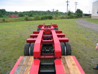 The rear frame is detachable so that additional deck can be inserted.  Additional weight distribution can be achieved by using camber blocks at the joint of the detachable deck.
