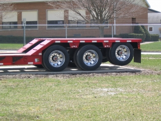 CR50's tri-axle rear frame.  Pictured Options: Air lift on the 3rd axle, wheel covers, and aluminum wheels.