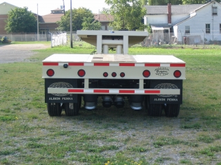 The rear impact guard is welded tot he rear channel below the extension.  The square opening on top of the rear deck is for access to the mechanical height control of the air ride suspension.