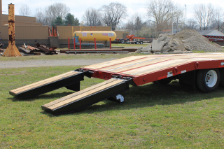 The beavertail angle of 8 degrees provides safe and easy loading of machinery. ROGERS E-Z Flip ramps have springs installed to assist lifting the ramps off the trailer deck as well as off the ground.