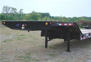 The gooseneck beams and main beams are made of 100,000 psi minimum yield steel.   The pin type landing legs have 40,000 lb. static capacity.