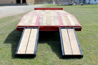 E-Z Flip ramps shown positioned inboard make loading of narrower machines safe and easy.