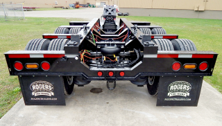 A view from behind the trailer (including the removable/flip 4th axle) shows the lowered