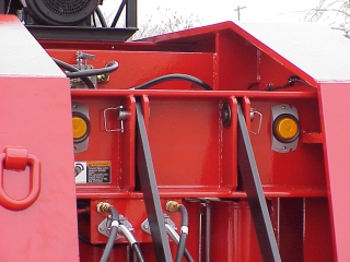 The ram-foot gooseneck is equipped with customer specified clearance lights, and a hydraulic selector valve to choose power from the gas engine or a tractor's wet line.