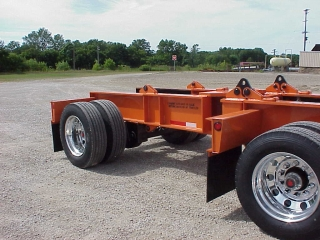 This booster axle assembly is designed so the trailing axle can be unpinned and connected directly to the trailer.