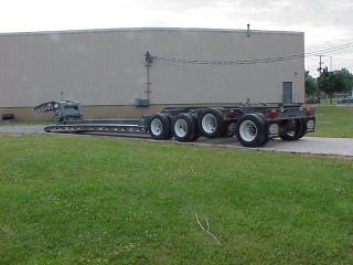 This trailer has air ride suspension, air lift on the 3rd axle and a removable 4th axle - which can be flipped onto the rear.