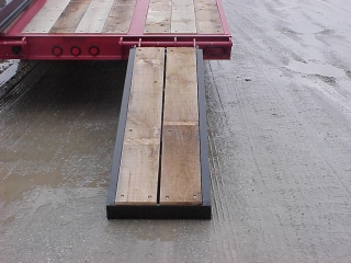 "The powder-coated ""E–Z Flip"" ramps are laterally adjustable for loading equipment of different widths."