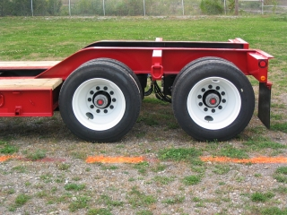 This view of the rear frame shows the oak decking to the tires, and the narrow outriggers bewteen the steel disc wheels.