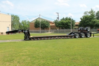 Photo caption: Rogers Brothers Corporation has been designing and manufacturing high performance lowbed semi-trailers with capacities ranging from 20 tons to over 100 tons for nearly 110 years.  Custom-engineered trailers are designed to meet the needs of the transportation, oil, gas, steel, mining, utility and heavy-haul industries.