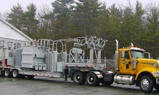 ROGERS® custom-built trailer, designed as a mobile substation for Unitil Energy Systems. The entire unit, including the tractor, had to weigh in at less than 99,000 pounds.